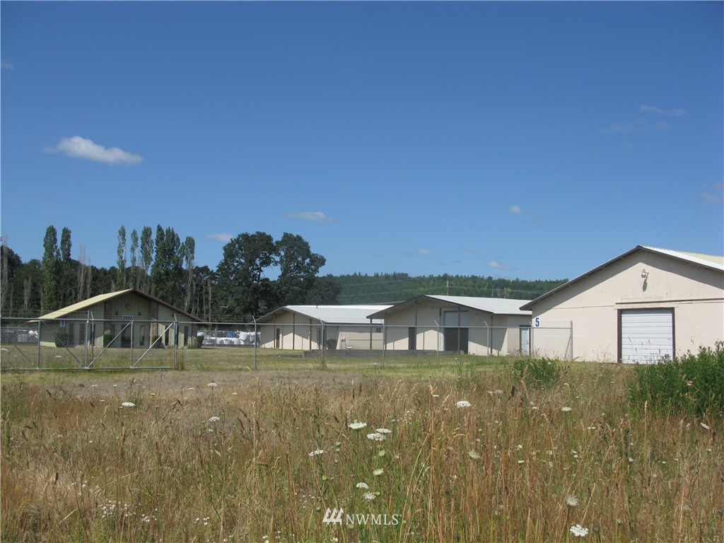 Great business site in fast growing industrial area with railroad spur for shipping from the site.    Minutes from I-5 and 20 miles from a deep water port.  Property has office space with a showroom, and 4 large industrial bldgs with individually metered 440 power and private well for utility savings.  New roofing on 3 warehouse buildings and newer rolling high bay doors.   Private location with security fencing and large level open acreage perfect for expansion! Includes parcel #023587003002.