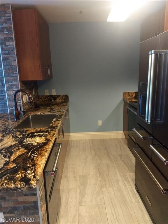 Outstanding STRIP VIEW 17th floor one bedroom Allure Condo. Owners have spent over $50,000. renovating this like new condo. Polished porcelain tile throughout, Magma Gold Granite, Moen Touchless Faucet, Stainless Steel KitchenAid Appliances & Samsung washer & dryer remain. Bardeen copper vessel sinks with glass mosaic exterior in custom bath. 24 hour Concierge Service, Pool, Spa, large work out area, business center, conference & lounge area.