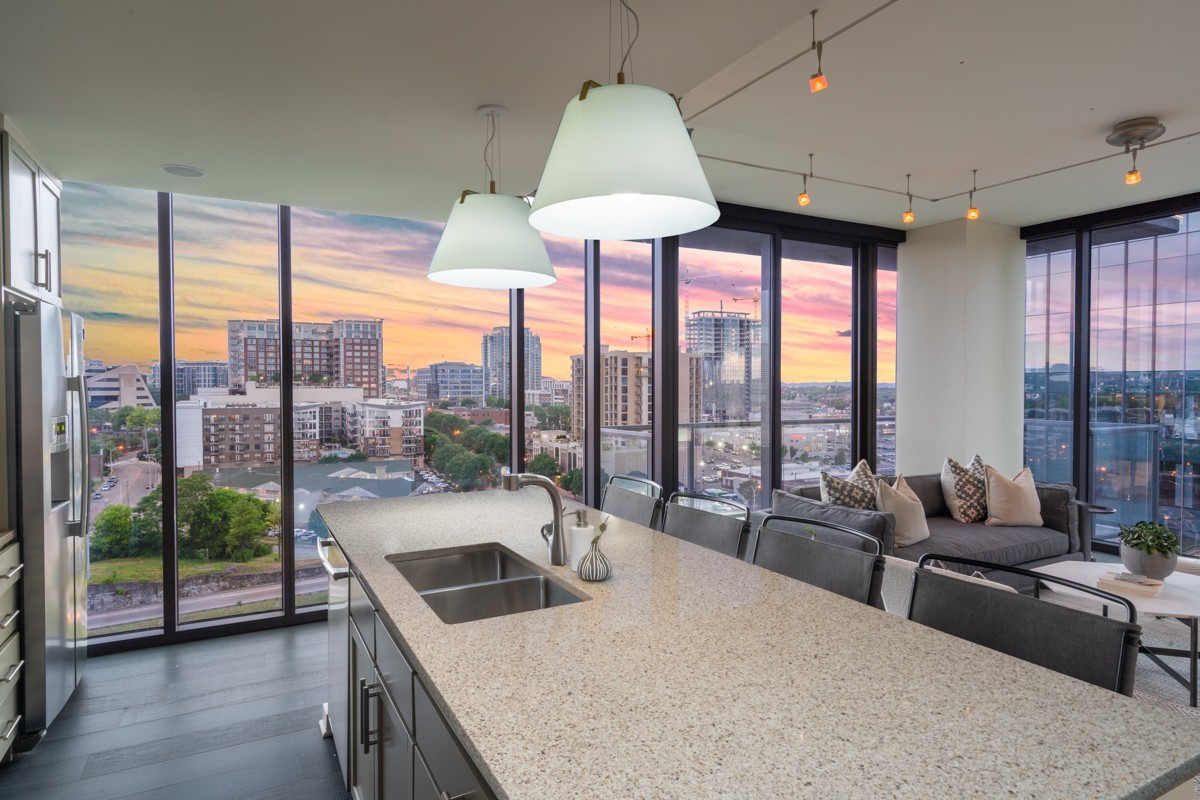 Coveted corner residence in the Gulch's most alluring high-rise residential tower. The wrap around balcony reveals stunning views of downtown as well as sublime sunset view over midtown. This 2 bedroom 2 bath plan offers a spacious layout with a split bedroom design, eat-in kitchen opens to the living area surrounded by floor to ceiling windows. California Closets, Mechanical Blinds, and two covered parking spaces convey with the sale. Currently unoccupied, showings are easily accessible.