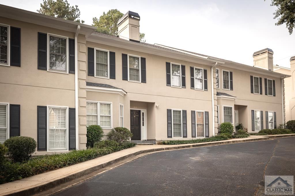 You don't want to miss this rare opportunity to purchase a one-level, ground floor condominium in prime Five Points neighborhood of Dearing Street Historic District. This location cannot be beat - 15 minute walk to Sanford Stadium, The University of Georgia, Normaltown, and Downtown Athens Restaurants, shops & music venues! 437 Waddell Street has been updated with newer hardwood flooring in the living areas, stainless steel appliances, subway tile backsplash, stainless single basin sink, and cabinetry hardware. The kitchen includes a pantry and breakfast area with big, bright windows. Spacious living room features a gas fireplace with marble surround, recessed and spot lighting, and french doors leading to the beautifully landscaped patio area. 9ft ceilings throughout! The owner's suite offers two large closets, new carpeting, and an ensuite bathroom w/ separate shower and a garden tub. Multiple storage closets down the hallway leading to the guest bedroom or home office. NEW HVAC and water heater within last 1.5 years! Call your Realtor today to see this great find in Dearing Oaks!
