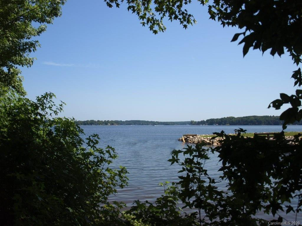 ***NO HOA*** Pristine Lake Norman waterfront with a beach area and long range main channel views. 212' of water frontage Rip rap in place, wooded 1.166 acre gently sloping lot in a quiet location just waiting for your imagination. No time frame to build. . preliminary Dock Proposal and soil report for a 4 bedroom septic system attached. Bring your own builder. Well and septic. Crawl space or basement foundation allows different possible options for your desired home site with long range views.