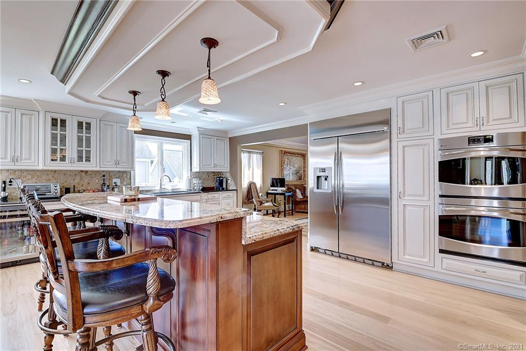WOW!   No expense was spared in this custom ranch near the Glastonbury line.  Perfect house for a couple who loves to entertain and enjoy a spacious yard and upscale touches.  Plenty of room for a pool.  It would also make a wonderful family home, close to top rated private K-12 schools in the area.  The car enthusiast will appreciate the 4+ car drive through garage with finished bonus room and full bath upstairs including heat and central air.  The entertainer will love the expansive kitchen with top of the line stainless steel appliances huge center island, tons of windows and natural light, great pantry  and open to the dining area and living room and built in bar area .  The first floor master suite is massive and includes a vaulted ceiling, full bath with steam shower and huge walk in closet.   2 guest rooms another full bath and the laundry room are on the first floor.  The fourth bedroom suite is located on the 2nd floor.  Continuing to the finished lower level there is a media and wine cellar.  Custom hardwoods through out the house.  Professionally manicured yard. This house is not to be missed!