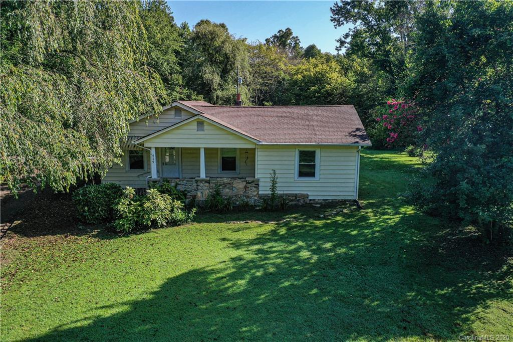 This unique, single-family home is just minutes from Downtown Hendersonville, but also has a feel for the countryside. The home consists of 2 bedrooms, 2 bathrooms, living room, dining room, kitchen, mudroom and bonus area, situated on 3.25 acres. Schedule a showing today to view this beautiful property.