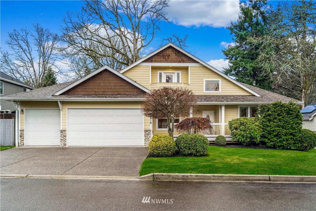 Unique home with Lake Steilacoom Access.  Great sought after floor plan that provides core main floor living.  Open concept kitchen to family room with slab granite island overlooks manicured back yard & large deck for entertaining w/ low maint decking. Family Room and Living room both w/ gas fireplaces, unique details like vaulted ceilings, french doors to the main floor den, extensive hardwoods, central vacuum, and even A/C.  Main floor owners suite with 5 piece bath & jetted tub.  Upstairs holds 3 beds, full bath. Quaint front porch and intimate neighborhood on a dead-end street with sidewalks.  Enjoy the water with lake access.  Fresh and Unique in the market.