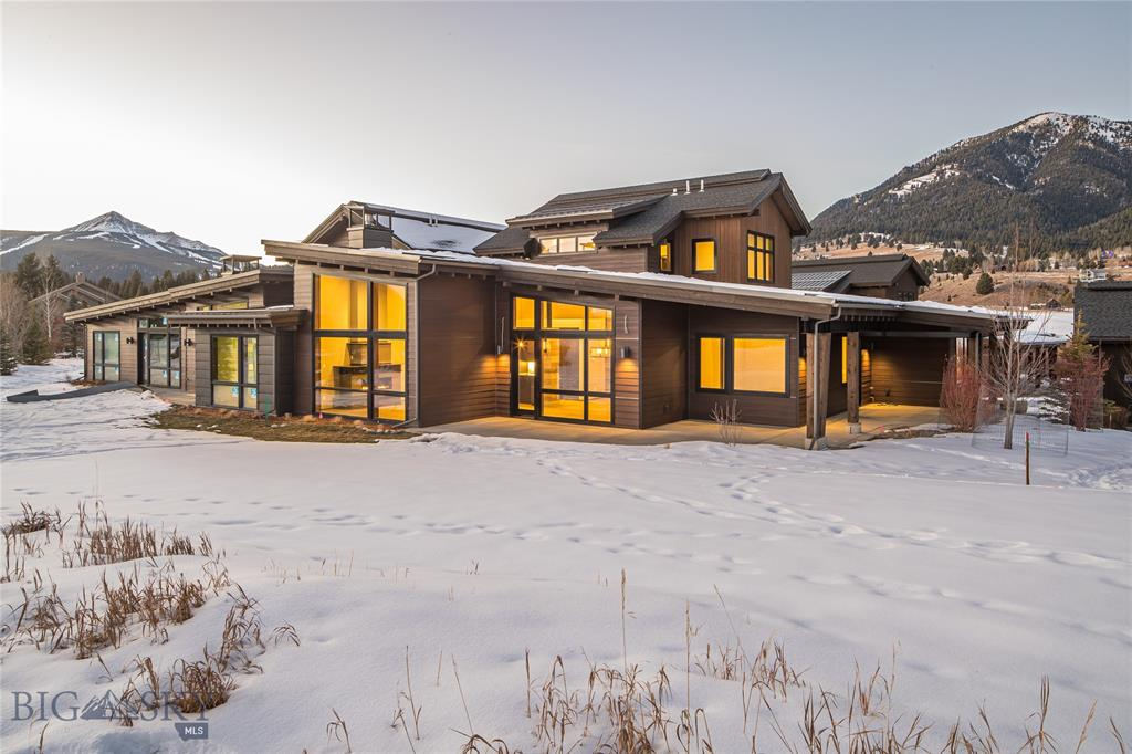 """Enjoy luxury living in this unique mountain contemporary condominium, in Big Sky's Meadow Village. This 3 bed + den, 3.5 bath property offers floor to ceiling windows, steel beams, radiant in-floor heat, wiring for """"smart"""" home technology, two-car garage, and on-site storage for your toys. The 19th is located on Big Sky's golf course with amazing summer access and ski-in/ski-out to the nordic trails in the winter. The neighboring wildlife andstunning mountain views complete this tranquil and convenient location in the heart of Big Sky"""