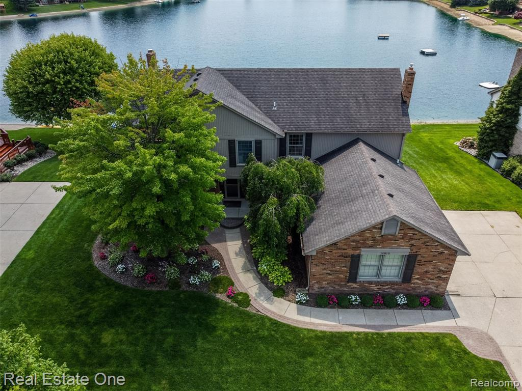 WOW*INCREDIBLE OPPORTUNITY TO OWN A BIT OF HEAVEN ON NON MOTOR SPRING FED BURLINGTON LK*SOUTHERN EXPOSURE*100 FT OF FRONTAGE*UPDATED T/O & SHOWS LIKE NEW*1ST FLR OFFICE W/FRENCH DRS & BAY*LG GREAT RM W/GORGEOUS STONE GAS FRPL OVERLOOKING LAKE W/MANY WINDOWS TO MAXIMIZE VIEW OF LAKE, CATH CEIL, SKYLIGHT, WET BAR SPACE & FRENCH DRS TO DECK ACROSS BACK*FORMAL DIN RM W/HRWD*UPDATED KIT W/QUARTZ, HRDWD, ISL & PLENTY OF CAB & COUNTER SPACE TO ENTERTAIN, DRWL TO DECK*1ST FLR LAUNDRY*TAKE END CAPPED STAIRS UP TO MASTER SUITE W/PRIVATE BATH, WIC, 2 MORE CLOSETS, FREE STANDING TUB, STUNNING SHOWER, VANITY W/DUAL SINKS* FSHD L/L W/O W/2ND KIT W/GRANITE, CERAMIC, BACKSPLASH, DISHW, MICRO, REFRIG, STOVE PLUS HUGE SPACE FOR ENTERTAINING, 2ND GAS FRPL, 5TH BDRM W/DRWL TO PATIO OR 2ND OFFICE & PLAY RM W/POCKET DRS & BEAUTIFUL CERAMIC FULL BATH*STORAGE IN BSMT*SPECIAL FEATURES: CROWN MOLDING T/O, WAINSCOTING, RECESSED LIGHTS, NEW FIXTURES, FAUCETS, FRENCH DRS, CEILING FANS, QUARTZ & GRANITE T/O*BATVAI