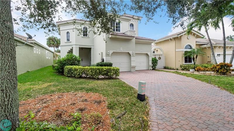 Coral Springs with Parkland schools! Welcome home to this beautiful 4/3 home in Prestigious Heron Bay. This 2 story home features: first floor master suite with tray ceiling & custom walk-in closet system, first floor guest room, volume ceilings, updated kitchen w/ granite counters . crown molding, tile floors in living areas, wood floor in bedrooms, large formal dining room, loft, Jack & Jill guest bath, laundry room w/ storage, screened-in patio.HOA Maintenance includes lawn care and common areas,Exterior painting,Pressure Cleaning,Tons of amenities: 2 Fabulous clubhouses, 2 community pools, children's water-park, tennis, basketball, fitness center, playground all located in a 24 hour guard gated community. Close to top rated schools, shopping, dining and Sawgrass.