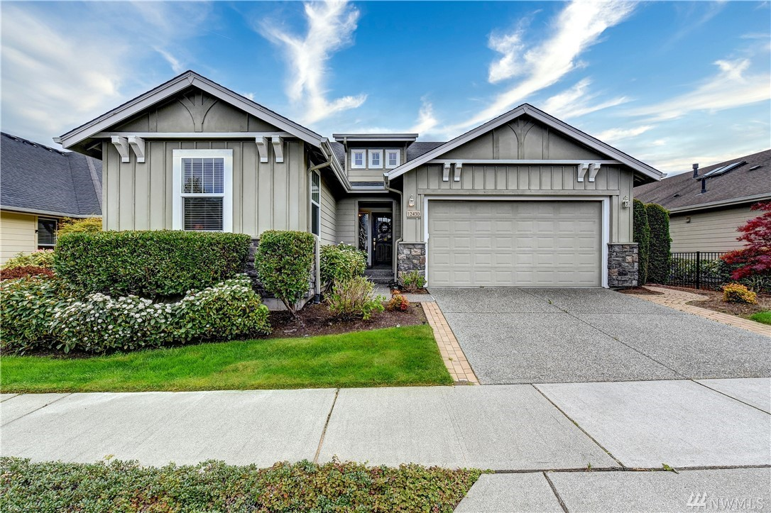 Wonderfully warm Whidbey plan-Maple hrdwd flrs thruout main living areas-Walking Dstnce to the Clbhse-Open kit W/wrm tone cabnts-pull out shlv-island+cabinets galore-Liv rm w/BI media cnter+surrnd sound-Loads of wndws+French drs out to a cverd patio w/outdr speaker sys+yrd is designed w/a wtr feature-srvce bar+custom hardscape make this grt for entertaining-den features B-I ins w/a spcial pull out+guest rm w/full bth-The garage floor is specially coated+all shelving+cabinet are inc-53+ community