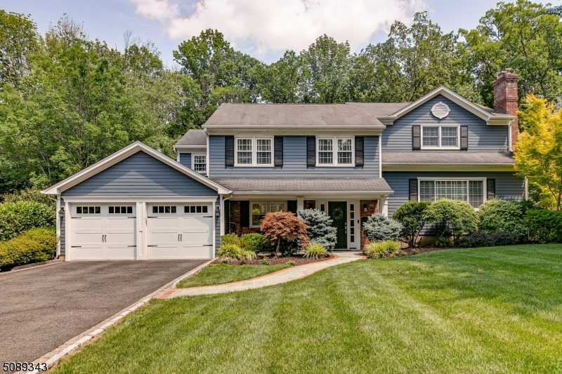 Meticulously Maintained and Renovated Colonial Split Level Home!  It's feat incl a gourmet EIK with Center Island, Quartz Counters, High End SS Appls, Pantry, Desk area & access to the covered porch that overlooks the beautiful yard & inground pool, LR with a FP, a Bulter's Pantry that leads to the FDR, Fam Rm with a FP, built-in bookcases & French doors to the sunroom, 5 BDRM including the master suite with 2 WIC, sitting area & full bath on the 3rd level, a second ensuite BDRM on the 2nd level  & a bdrm on the ground floor.  The main floor laundry room, office off the master suite, mud room that leads to the 2 car att garage, HWF, finished bsmt & many recent improvement adds to its appeal.  This stunning home situated on .494 acre on a cul-de-sac in a sought after Berkeley Heights neighborhood has it all!!