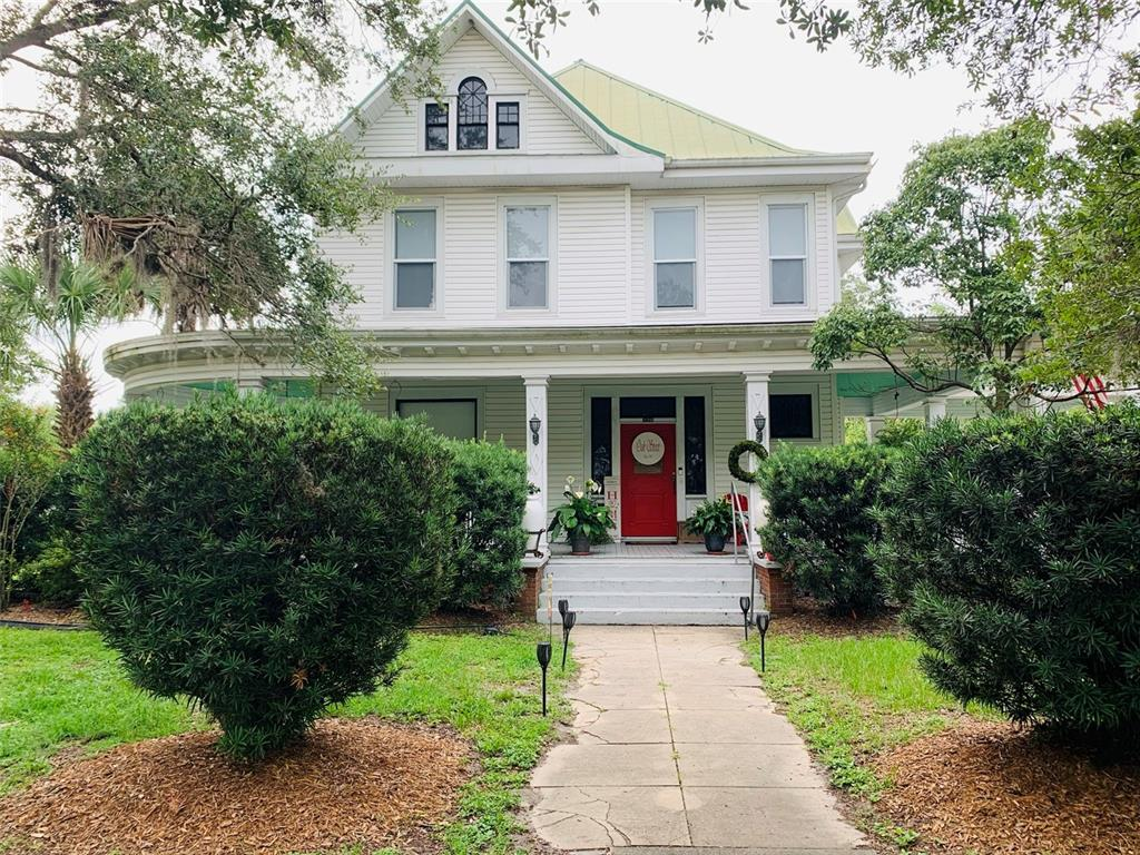 Gorgeous Post Victorian 1917 home with 7580 sq. ft. of Southern Charm. The actual year built is believed to be 1907, however, property appraiser has 1917. This home is one of the few w/ twelve ft. ceilings upstairs & downstairs, a basement, attic, pool and has been continuously updated & well maintained. It has the original hard wood floors upstairs and downstairs w/ornate wood carvings throughout. Enter into the large foyer of this magnificent home and be in awe of the large rooms and open floor plan. Downstairs rooms have 10' solid wood pocket doors for privacy when needed. Foyer has a large staircase featuring 2 landings as well as a 2nd narrow staircase, once used by housekeepers, w/access from the kitchen to the upstairs living area. The huge master suite is located on the first floor & opens onto a covered lanai overlooking the sparkling pool. Large master bath & dressing room has an open handicap accessible shower and 2 big walk-in closets. Three bedrooms & three bathrooms upstairs along with a game room/library that extends the width of the house and could easily be converted to another bedroom. The home's large kitchen has beautiful cherry wood cabinets, built-in desk and china cabinet along w/a separate butler's pantry. Large formal dining room is ideal for entertaining. Perfect for family home or Bed & Breakfast. This home is a Historic Treasure