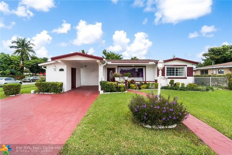 Great spacious 3/2 LAKE FRONT CORNER LOT HOME IN LAUDERDALE LAKES LOCATION CLOSE TO EVERYTHING. THIS SPACIOUS SPLIT LEVEL HOME - The home features tile floors and Accordion shutters throughout home. New Gutters around the house . A/C from 2007, ROOF from 2012, WATER HEATER from 2018. Fenced backyard with shed and room for a pool. Backyard features many different lush fruit trees, bananas, mangos, jackfruit and plum trees just to mention a few.