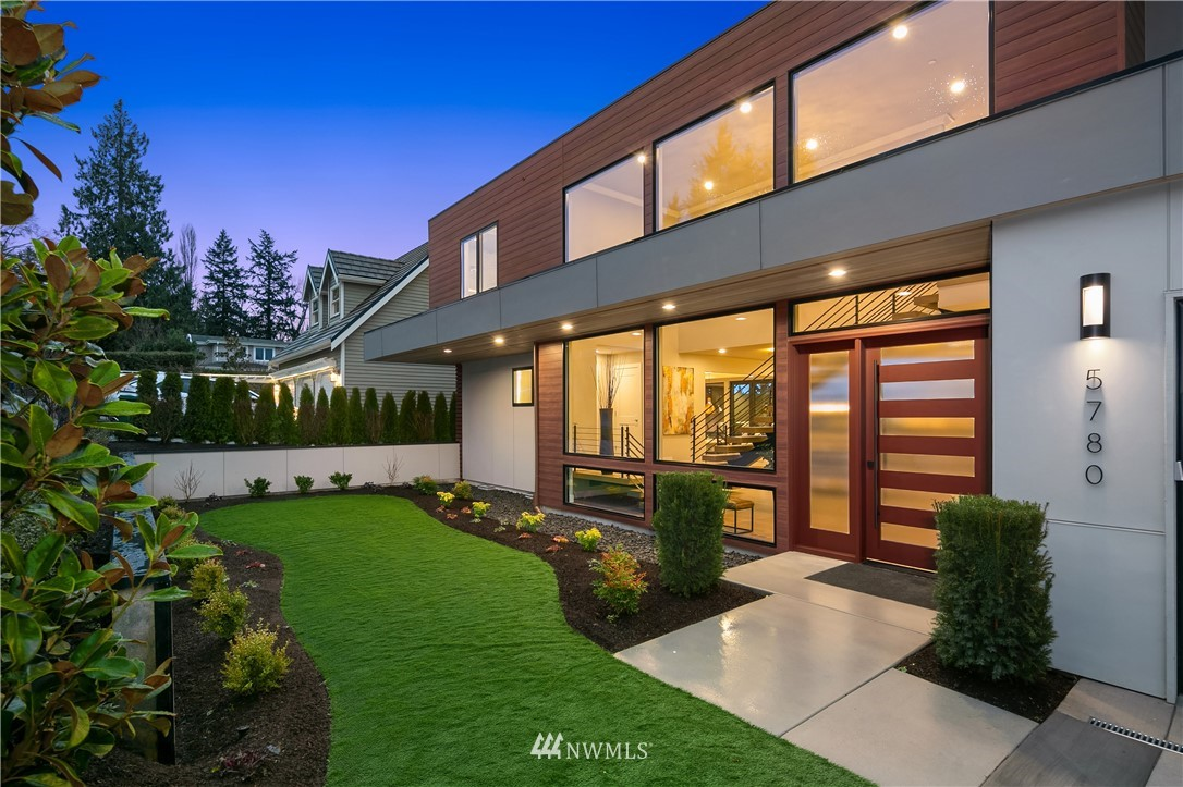 """Boasting amazing views of Lake Washington and the Olympics, this rare double lot opportunity has an expansive front lawn on a separate parcel offering limitless options for future use. McCullough Architects provides a fabulous design with Anderson windows, LaCantina Sliders, heated/covered outdoor living with fireplace, BBQ, fridge, plus massive 20-foot-tall great room ceilings. Chef's kitchen with island, pantry, 48"""" Wolf, 72 """" Sub-Zero, and accordion windows that open to covered patio. Dramatic open living with floating stairs, designer powder, main floor guest suite plus office. 3 guest suites feature lake views. Expansive master wing with two walk-ins, fireplace, and luxury 5-piece bath. The roof-top deck takes views to the next level!"""