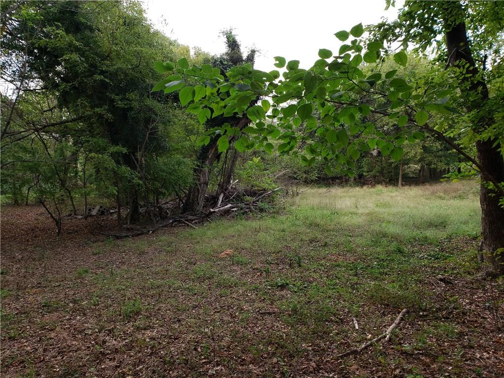 Beautiful piece of land just off Alameda.  Grass area surrounded by a ton of mature trees.  Perfect to build your new home on!