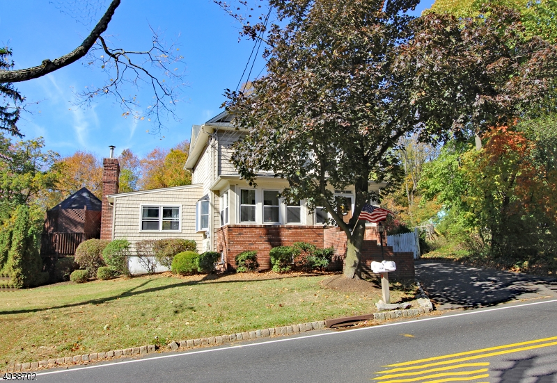 Unique property with two separate homes.These homes  generate substantial yearly income with two separate residences. Ideal for mother daughter living.The front house has 4 bedrooms and 2 full baths. Also has living and dining rooms with large family room which has a woodburning fireplace. Sliding glass doors lead to a large deck with gazebo. This house also has a large walk up attic for storage and a cedar closet. Large yard separates the 2 homes. The second house offers 3 bedrooms with 1 full bath. Kitchen, dining room and living room, and 2 bedrooms are on the 1st level.  Spiral stairs lead to a large bedroom and walk-in closet on the 2nd level.  There is also a large patio. Oversized garage accomodates 2 cars with additional 3 car parking in the driveway. There also is a storage shed in the backyard.