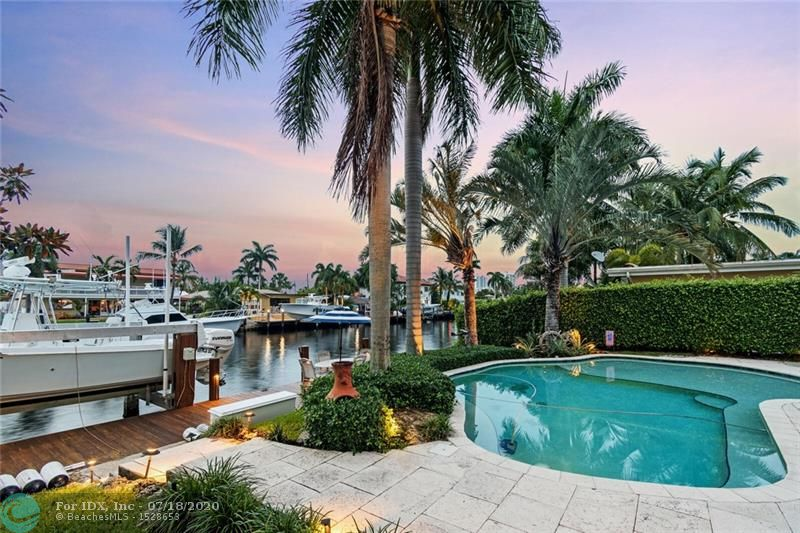 Enjoy the South Florida lifestyle as you watch boats pass by in your own backyard paradise! Beautiful Three Bedroom Pool & Waterfront Home in desirable east Pompano Shores! Once you walk through the front door, you are greeted with a Wide Open Dining Room & Spacious Living Room overlooking the pool and water views! All rooms of large scale, Walk-In Closets. Designer Kitchen has granite countertops, storage space, open island for dining! New A/C Unit with air filtration filter! Two car garage & plenty parking with circular driveway! Entertain guests in a beautiful outdoor oasis with a newer pool complete with salt water system! Perfect home for boaters! Only a few homes from the Intracoastal! Wide Canal for large boats, Boat Lift, No Fixed Bridges, and Direct Access to Intracoastal & Ocean!