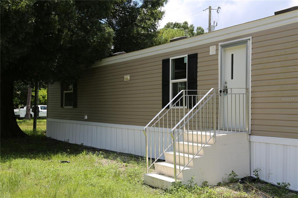 BRAND NEW 2 bedroom 2 bathroom manufactured home in Palmona Park.  No HOA or lot fees, you own the land! Beautiful vinyl plank floors, open floorplan, with all new appliances.  Kitchen leades to separate laundry room with washer/dryer hookups. Bedrooms on opposite ends of home. 2 separate entry ways into your home, you choose. House to rear of home encroaches on part of property. Driveway to be leveled prior to closing. Conveniently located off of Bayshore Rd (SR78) and 41. Less than a mile to Walmart, Home Depot and shopping. Restaurants and nightlife in downtown Fort Myers is only a 10 minute drive away.  Don't miss out on owning your brand new home this won't last long!