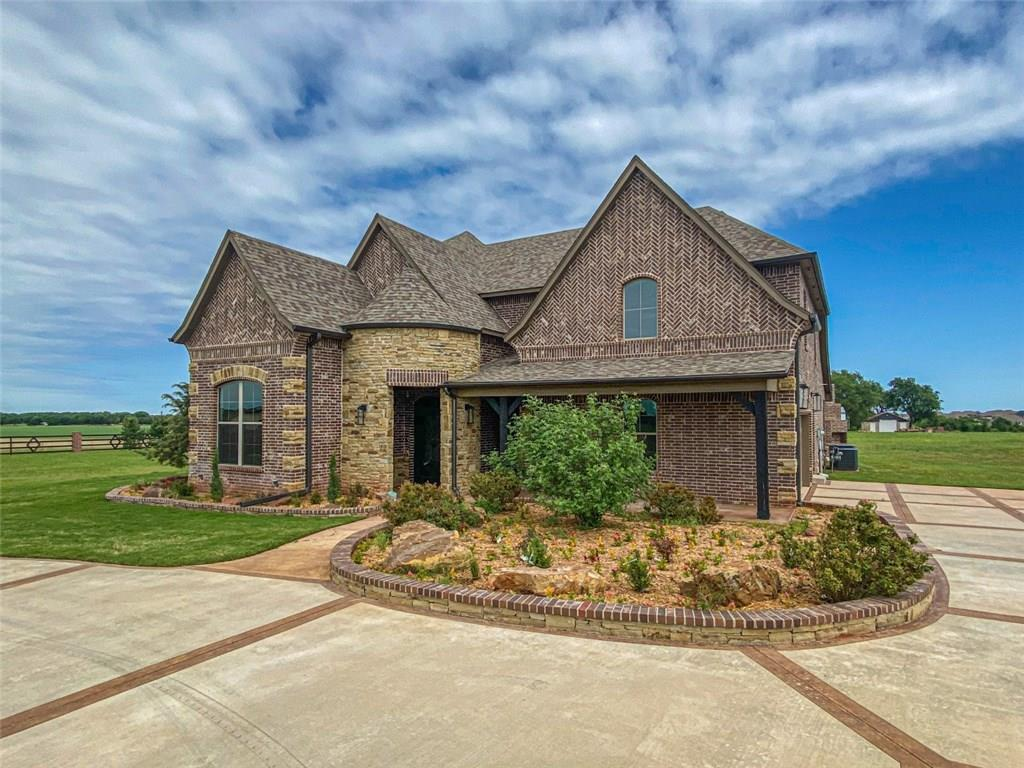 Stunning open concept home on 3/4 acre (MOL) in Deer Creek schools! This home is not short on quality, thoughtfulness, or luxury finishes. You will find a functional floor plan, ample storage and closet space, Monte Cristo doors, custom built-in bookcases in the study, designer finishes and styling in all of the bathrooms, industrial lighting, cathedral like living room ceiling, covered patio and outdoor fireplace. The kitchen will knock you off of your feet with beautiful woodwork, chef size stove, double ovens and an entertainers island that is sure to WOW! The master is on the main floor and the rest of the bedrooms are upstairs along with the second living. Unfinished bonus space off of the garage that would be wonderful for an art/play/hobby/homeschool room or even for storage for sentimental or temperature sensitive items. 