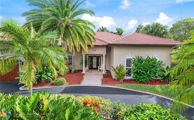 This beautiful, meticulously-kept split 3 bedroom, 3-1/2 bath home with 2,036 sq.ft. under air sits on 75' of the tranquil Tarpon River in the private gated community of Tropical Point, with no fixed bridges and only 2 houses off the New River. Relax on your covered patio with skyline views and enjoy watching the Jungle Queen and all of the  yachts pass by. With 12' high ceilings, marble floors and open concept living, this home is an entertainer's dream. The kitchen features top of the line stainless steel appliances and a 15' curved granite bar. The master bedroom boasts a 16' x 5' walk-in closet with built-ins. There are PGT hurricane impact doors and windows throughout the home andan extra large attic. A circular driveway with a full size 2-car garage accents this Beauty On The River.