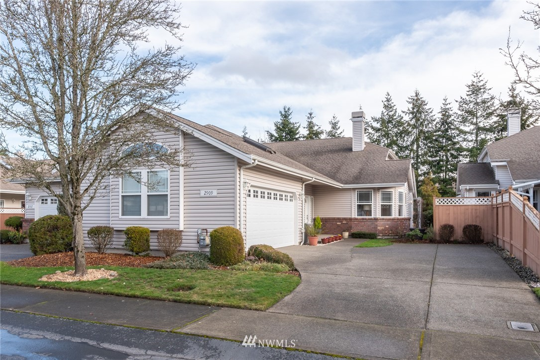 Beautiful home now available in one of Pierce County's most Prestigious 55+ communities. This 3 bedroom, 2 bath  has been lovingly and meticulously maintained and the pride of ownership shows. Tons of natural light and vaulted ceilings give the living area a fresh and open feel. Large updated kitchen with eating space as well as a bar that passes through to the dining room. Master bedroom has private bath, a massive walk-in closet. Private backyard is perfect for entertaining.