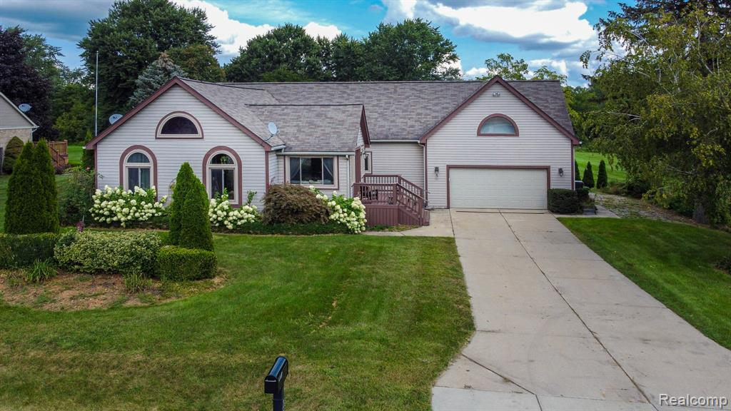 Beautiful open concept Ranch home, in Rochester Hills!! The home has everything you need for indoor/outdoor entertaining. Open concept great room, dining, and kitchen!  Fall in love with the natural light pouring in through all the windows! Master bedroom has walk in closet and en suite bathroom.  Two additional bedrooms, and second full bathroom. 1st floor laundry room and large pantry off the kitchen.  Kitchen is completely remodeled and has plenty of cabinet and counter space! Invite family and friends to your large entertainment bar, behind a huge 2.5 car garage with 12 ft ceilings, where you can open up your barn doors, leading out to your 0.95 acres. Relax under the pergola with your own sand and fire pits. No association. This home's living space has been accessible to home owners with physical challenges; wide hallways and easy install of ramps at entrance and inside garage. Award winning Rochester Schools. Schedule your showing today!