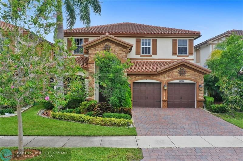"""Beautiful lake front, extra large fenced yard. Simply Stunning Summit model 5 Bedrooms 4 full baths and bedroom on the first floor in beautiful MiraLago, Impact windows and doors, gas cooking , white kitchen, no carpet, molding,, neutral 20"""" diagonal tiles, custom closets.Larger lot, fully fenced, with great sunsets and grassy area. Amazing gated community with resort-style amenities including gym, tennis, basketball, billiards room, tot lots, kids water park and amazing party and ballroom. A+schools. Better than new with no builder fees."""