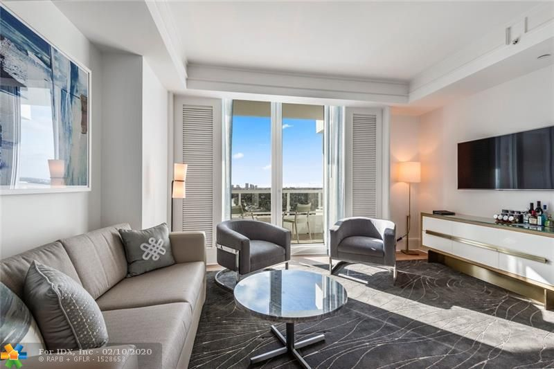 Newly renovated condo-hotel, Nauat The Ritz-Carlton Ft. Lauderdale Beach. The only 5-Diamond award winning property in Ft. Lauderdale. Luxury resort living make Ritz-Carlton, residence ownership unique and outstanding.   Living room with pull-out sofa bed and a well-appointed kitchen with high-end appliances allow comfort and flexibility.  The intracoastal view is panoramic & stunning. Sun, fun, world-class service & a wonderful social scene are just an elevator ride to the pool deck with restaurant, bar & Owner's lounging section. Order in-room dining 24/7. Valet, bellman, spa, fitness center with Peleton, retail shops. Participation in the hotel rental is optional and completly flexible, owners may stay in their condo as often as desired.