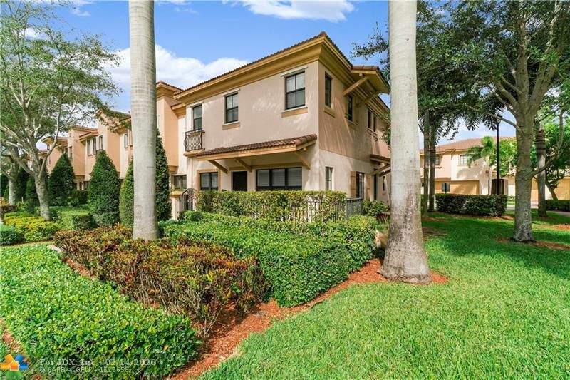 True pride of ownership, Bright & Spacious 3BR/2.5BA/2CG Townhome in highly sought after Grand Cypress!  Corner Unit w/lots of natural light, surrounded by lush green areas and guest parking.  Home Features: Updated Kitchen with S/S Appliances, Granite Counters, Wood Cabinets, plenty of counter space with a large breakfast bar. Tile throughout the first floor (grout just cleaned) & neutral paint. Master Suite has his and her walk-in closets, dual vanities, shower, and separate roman tub. 2 large guest bedrooms,  guest bath & Laundry on 2nd Fl (New Washer). Private Patio for entertaining.  Hurricane Shutters.  Low HOA Fees!  Comm Pool & Tot Lot, great schools, near major highways and shopping. Perfect for families, pet lovers and investors. The property can be rented right away. FHA Okay.