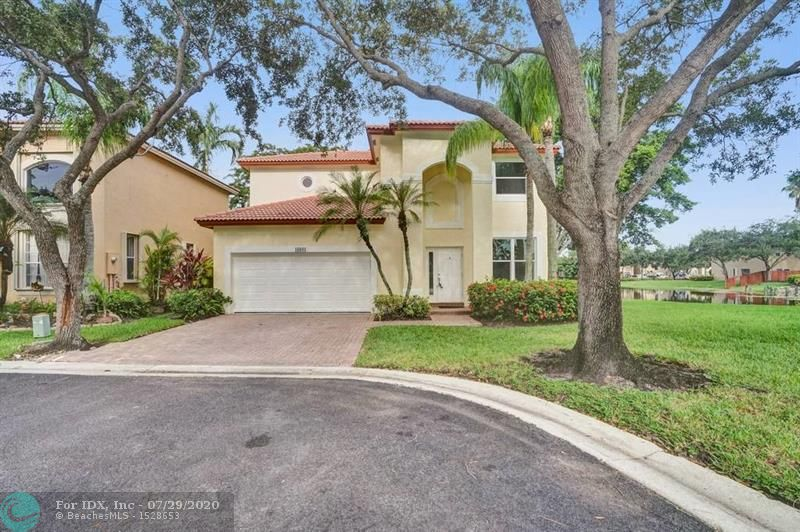 Carefree Florida fun in Weston! This beautiful Emerald Courts, 4 bedroom, 2.5 bath LAKEFRONT home is on a GREENWAY leading to the community pool! Recently painted inside and out with a 2-years new AC system with germicidal UV light. This home has many additional improvements including new Hurricane Impact Windows and Doors including a new garage door, an updated kitchen with new dishwasher, new washer and dryer, and newer refrigerator (2019), and updated bathrooms. Enjoy the home theater with retractable screen, ceramic tile, a convenient indoor laundry area, and extra storage in the large garage. Florida living at its finest! Come and see!