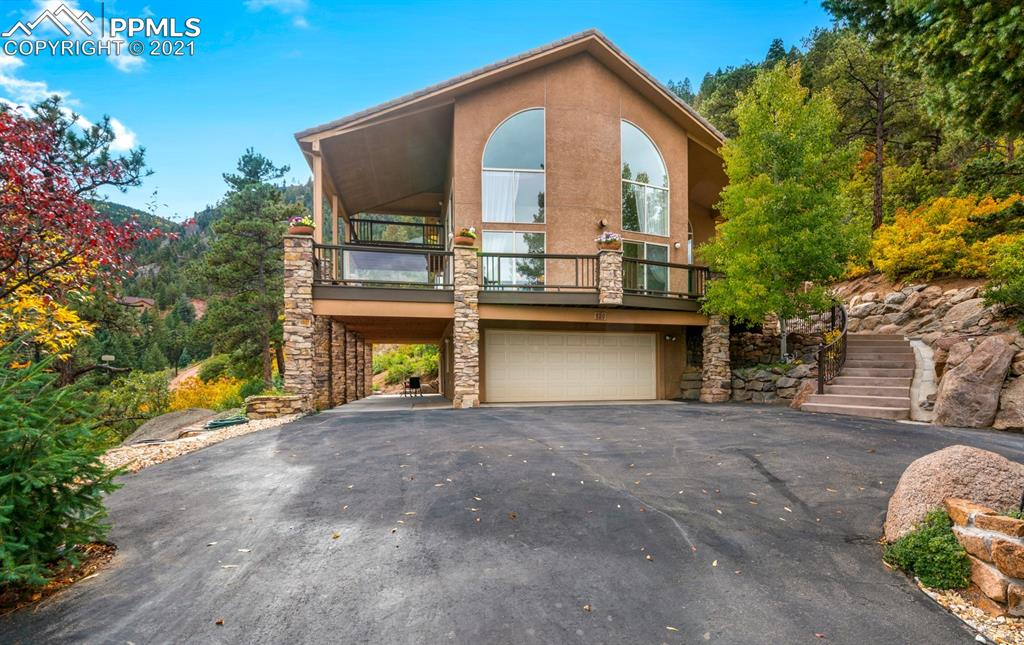 Welcome to WINDING STAIRS! Romance, comfort, style, designed to live like a resort home twice as big, in a secure, private setting surrounded by mountain & city views. Conveniently 6 minutes from Crystal Park security gate (1/3 of the way to the lake/pool), only 15 min from CS Safeway, 30 min from Ft Carson or N Academy. Main level is light, open w dramatic entry, soaring ceilings, double front doors. Greatroom has stone gas fireplace. Massive two-story windows drink in the light & exhilarating views. Gourmet kitchen features new Bosch stainless appliances, Jenn Aire downdraft range, maple floors & cabinets, granite tile. New Bosch fridge & Smart wall oven; 2 Bosch dishwasher system saves you 30 min everyday. Versatile 25x11 main level bedroom/office has closet & adjoining 3/4 bath. Unique architectural design features lit art niche up 3-level staircase that winds gracefully around a series of 3 closets fireproofed to be dumb waiter. These Fan-shaped stairs are a full 4-ft wide, lovely, comfortable. Top level is all Master suite designed for luxury, city views, skylight over bed. Oversized Jetta spa-tub has twin pumps, 16 jets, graced by 2 picture windows w private mnt views. Walk-in glass block shower w dual heads & stay-dry controls. Mstr has walk-out & laundry. Dressing area has built-in drawers & storage, plus 10x8 closet w mirror bifold doors:See yourself from every angle! Garage level has versatile entry room w closets, 18x14 walk-out bedroom & 19x8 unfinishd Utility/laundry plumbed for 3/4 bathroom. Oversized deep garage, dry-walled w workbench plus 8x7 side storage. Fireproof Concrete tile roof, stucco & 2x6 construction, hot water baseboard heat, tons of stone work. Outside, concrete steps are even wider, fan-shaped w curved custom railing. Check out the wrap-around deck and twin patios. Scenic paved driveway. Septic sized for 3 bds. Must see what art & creativity can do! No other like it, a luxury celestial observatory. Reliable Snowplowing.Try well water!