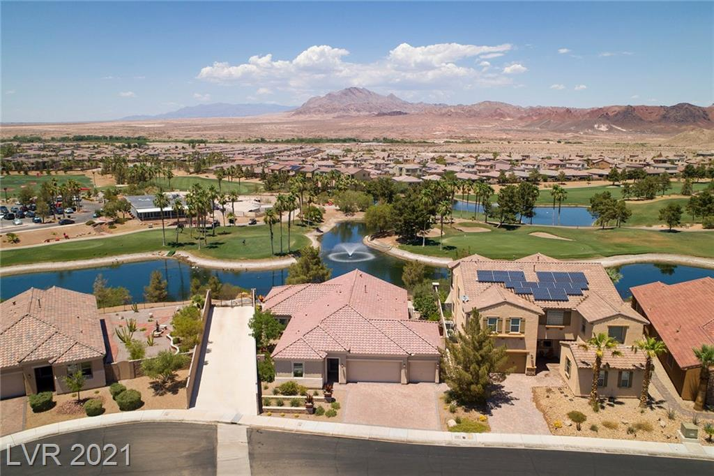ONE OF A KIND. Semi custom home with some of the best views in Tuscany. Elevated & private North facing lot with expansive 180 degree views of the Strip, Sunrise Mountain & Chimera Golf Course. Highly upgraded w/unique top of the line finishes & appliances including honed limestone flooring in living areas, custom millwork, Majestic Fortress 2/way fireplace, built-in shelving & cabinets in den, living room, second bedroom & dining room. Custom closets & cabinets with dressing room in primary bedroom. Custom draperies living room & Primary bedroom. Covered patio w/ built in TV, Built in BBQ, custom landscaped yard w/mature trees. Rare opportunity. 45,000 sq. ft. rec center w/ lagoon pool, lap pool, fitness center, indoor & outdoor basketball courts, racquetball courts, yoga room & pool room. Lge lounge area, caterers kitchen. Outdoor tennis & pickleball courts, volleyball court & playground. Community is home to the highly rated Chimera public golf course w/clubhouse, restaurant & bar.