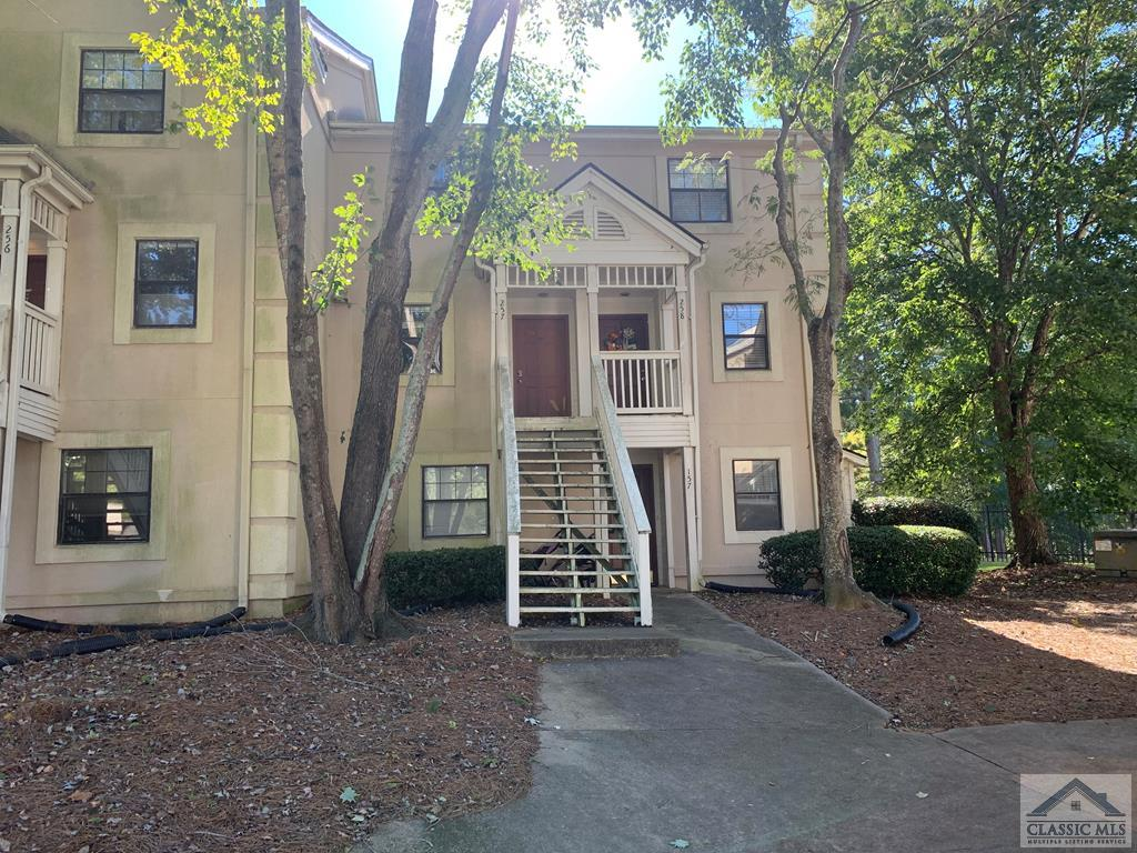 This condo offers great amenities and location for an excellent Athens price! DETAILS: *2 Bed, 2.5 Bath *1244 SqFt *Built 1983 *Appleby Mews HOA $140/Mo AMENITIES: *HOA includes swimming pool, exterior maintenance, and grounds maintenance *Just over a mile from the Arch / Downtown Athens *Roommate plan with two upstairs primary suites *Newer flooring in bathrooms, kitchen, and main living areas *Private covered back deck LAYOUT: *First Floor: Foyer, Kitchen, Dining Room, Half Bath, Family Room *Second Floor: Two bedrooms with attached bathrooms