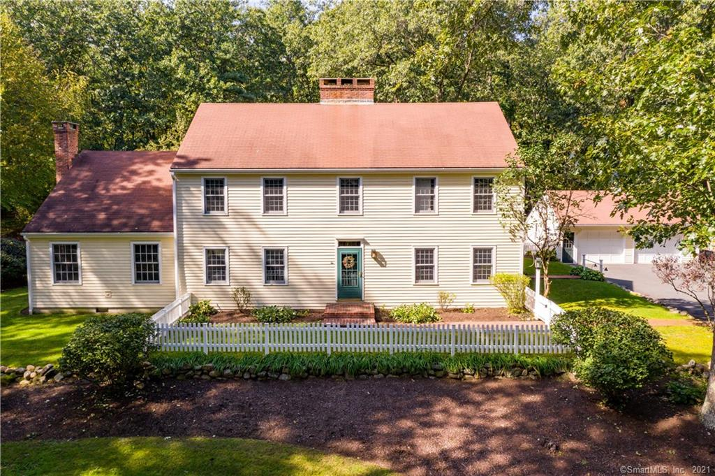 Introducing a colonial reproduction located in the heart of New England. The J.H. Morley built home was constructed using techniques & materials fashioned after home construction of the early 19th century. Salvaged wide plank flooring and large brick fireplaces are just the beginning of what makes this home so special. The dining room features a reproduction of the historic Phelp's Tavern bar and candlelight chandelier that makes for an extraordinary experience to share with guests. A total of 5 fireplaces plus separate wood stove are ideal for New England winters. The addition of a modern, open-space kitchen & family room area makes the spaces of the home as functional as they are delightful. Central vac, 3 zone central AC, heated bath floors, and stand-by generator are a few more of the modern amenities in this classic home. The main floor includes an au pair/in-law suite that is complete with kitchen, living room, bed & bath. The upper level houses a laundry room and 4 additional bedrooms, including a gorgeous master bedroom with gas fireplace, dual walk-in closets, and exquisite bathroom.  The over 4 acre property includes a sprawling front field, detached garage, large deck with gas firepit, and plenty of privacy. Located nearby Flamig & Tulmeadow farms, Simsbury Farms public recreation center, and endless outdoor activities. Simsbury, CT is recognized as one of the best places to live in CT and is located minutes from W. Hartford center & downtown Hartford.