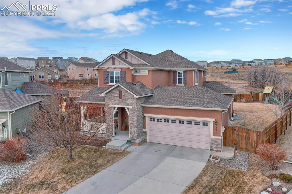 Hello Colorado home buyer! Have you ever driven by a home and said I would love to own that home, here is your chance. Amazing stucco home that backs to open space. 6 bedrooms, 4 bathrooms, 2 car garage on an almost a 1/4 acre lot. Hardwoods throughout the main level. Huge gourmet kitchen with amazing cherry cabinets and granite countertops! Formal living room with beautiful gas fireplace. Nice new storage shed in the rear yard. Huge 19 X 12 wooden deck out the kitchen and living room as well as a 15 X 12 private concrete patio walk out from the dining area. Whole home audio set up and surround sound set up in main level living room. Newly finished basement with 2 bedrooms, Huge family room with a custom theatre setup, big bathroom with a custom shower and dual sinks with granite counter tops. I could go on and on, but how about I just say, Welcome Home!!