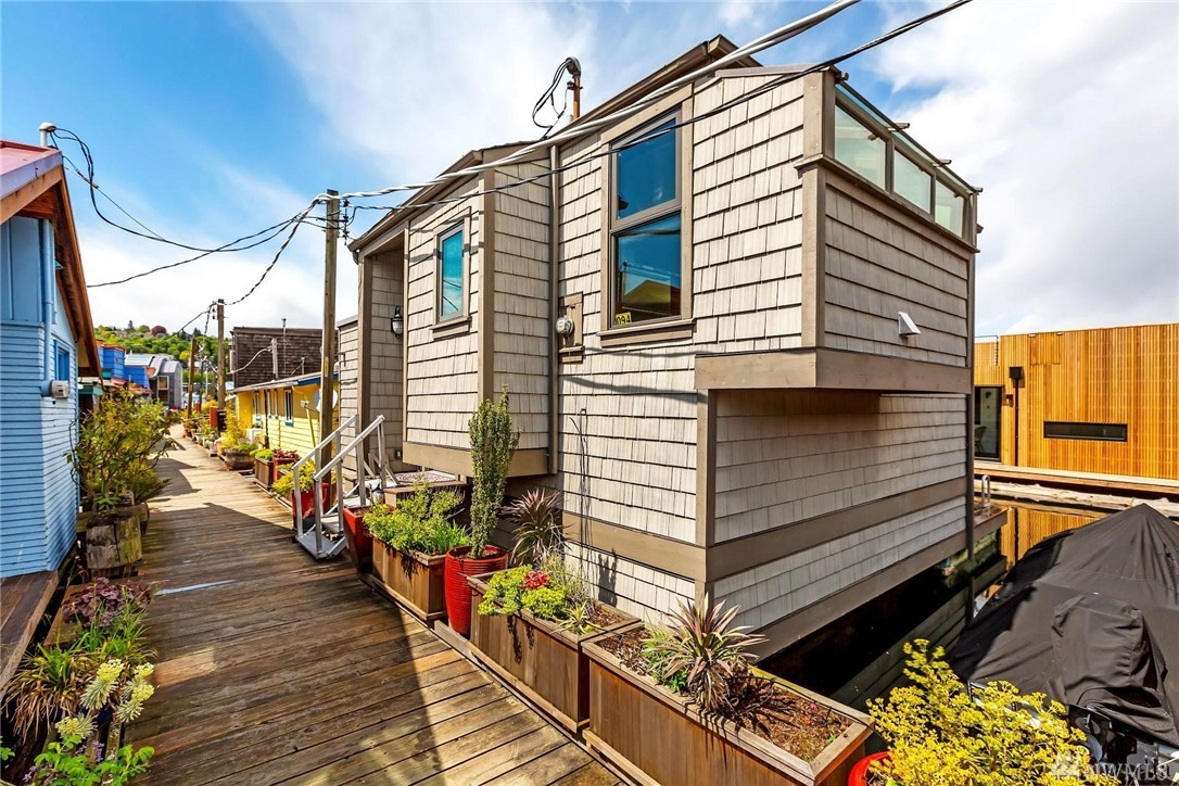 Recently remodeled floating home w/spacious living room, 3-panel wall-size windows open wide to private deck with built-in grill. Enjoy the expansive almost 270 degrees view of South Lake Union, Seattle Skyline and the iconic Space Needle from the upper floor or relax in your own little retreat outside the bustling city life and get cozy in front of the fireplace in the master bedroom. With ample closets, heated Travertine floors, new granite countertops & cabinetry, you'll never want to leave.