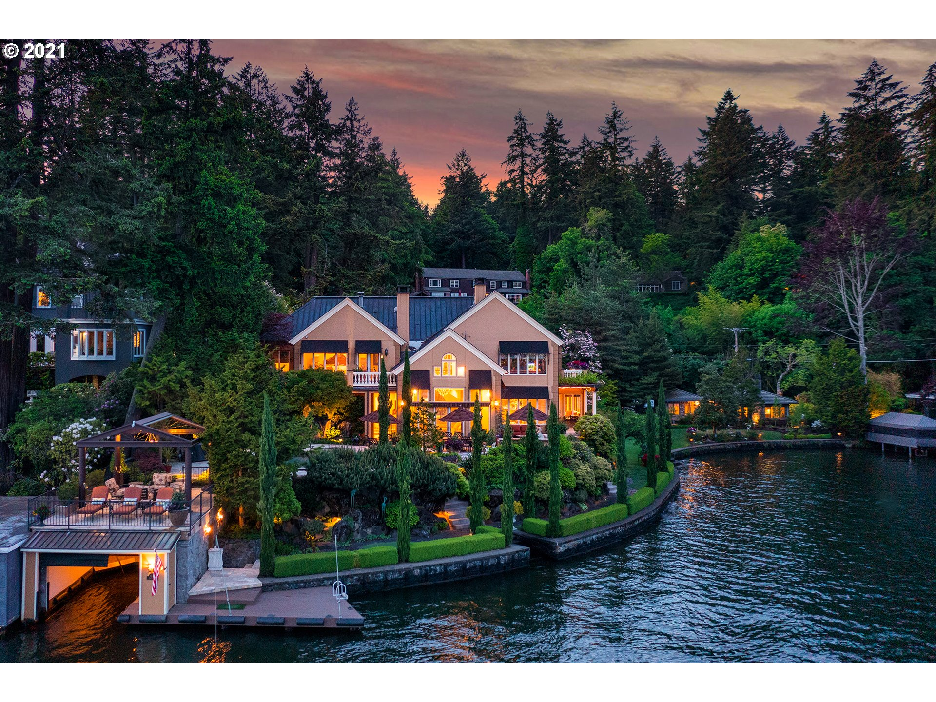 Every day is a vacation at your private 5-star resort on .5+ acre & 330 ft of lushly landscaped, prime water-front on Oswego Lake. Relax & entertain on the poolside patio & perfect your short game on the putting green steps from the water. Enjoy extraordinary European-inspired luxury design with sumptuous details & lavish amenities. Separate guest house perfect for visitors or multi-generational living. Enclosed boat house with water-level deck & dock. Gated property in LOs coveted North Shore.