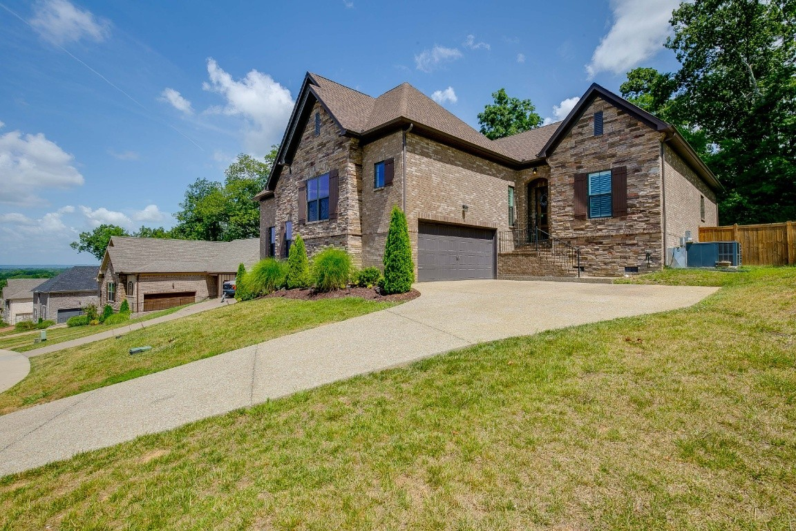 OPEN Layout~Main level living~10' ceilings~White kitchen~Granite~Subway tile~Gas cook top~Kitchen Island~Large Main level Owner's Retreat w/large tub~His/Her Vanities~Walk-in Closets~ Guest suite down~W/own full bath~Rec room & 1 bed & Full Bath on 2nd level~Great space for in-law or teen Suite~Fenced yard~Prime Lot  Common area to the right of this home & only one neighbor on one side. View the Nashville skyline, Old Hickory Lake & enjoy Hendersonville fireworks from the community Gazebo.