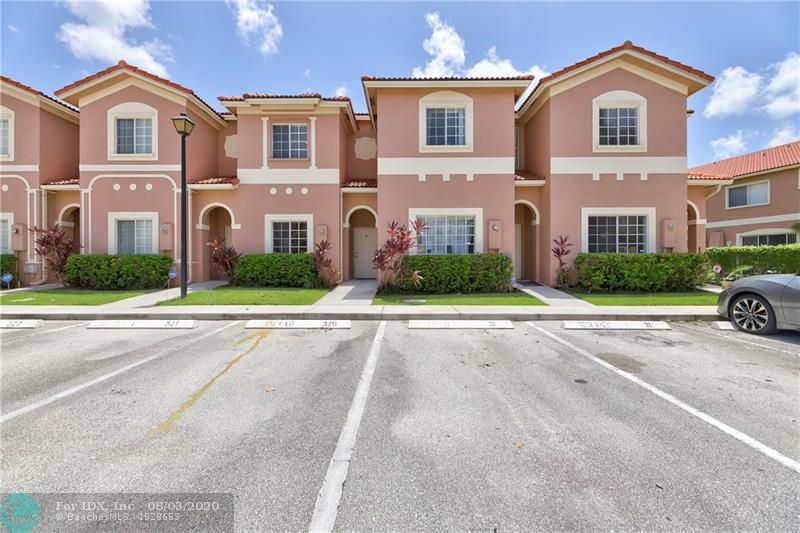 **MULTIPLE OFFER SITUATION AS OF 8/4.**Rarely available beautiful fee simple townhome in Catalina Lakes!  So clean, just bring your toothbrush! Features include newer kitchen with granite counter tops, stainless steel appliances, tile floors downstairs and upstairs with carpet only on the stairs, walk in closets in both bedrooms, a/c replaced 2016, new hot water heater, and washer and dryer upstairs and is one year new!  Faces the tot lot and pool is steps away from your back door.  No need to worry about any expenses!  Community allows dogs up to 25 pounds.  No commercial vehicles, two parking spaces plus guest parking.  Reverse osmosis system and a/c ozone unit is excluded from the purchase.  UV light for a/c will stay.