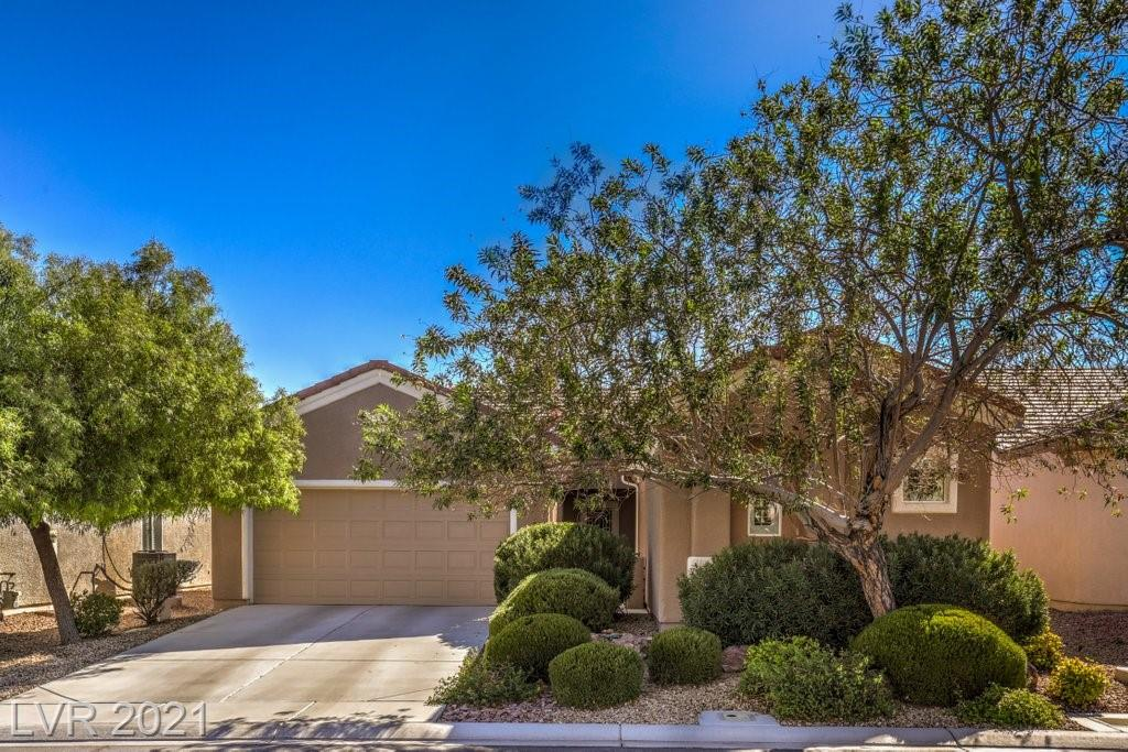STUNNING AND PERFECTLY MAINTAINED!  Popular Laurel Model With Casita!  Beautiful mountain views will make you feel as though you are living in your own private resort!  Enjoy your morning coffee in this beautiful gated courtyard or on the private extended patio in the backyard.  The beautiful kitchen gives you granite countertops, recessed lighting and convenient pantry!  The main home hosts an open floor plan, perfect for entertaining, gorgeous plantation shutters, along with 2 bedrooms, 2 baths and beautiful office.  Step outside and find the coveted casita!  Great for those family and friend visitors that love to visit Las Vegas.  Casita is complete with a large bedroom, full bath and large closet.  Only tile and laminate make keeping this home a breeze for cleaning.  The Laurel with a casita is the home you will want!  A MUST SEE!