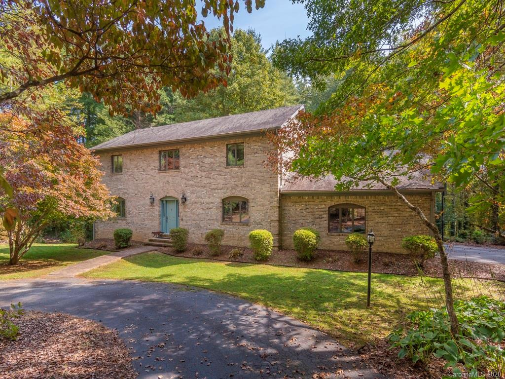 This custom built all brick home in a quiet south Asheville neighborhood has an updated eat-in kitchen and master bath, a marble foyer and hardwood floors. There is a great room / family room in the basement with a covered sunroom  with a hot tub .The roof has a 50 year shingle and the deck is trex. This home sits on a level 2 acre lot with mature landscaping.