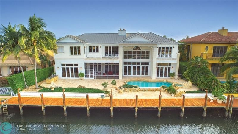 SPECTACULAR CUSTOM BUILT PLANTATION STYLE HOME SITS ON 100' OF WATERFRONT W/ BEAUTIFUL VISTAS FROM EVERY ROOM & JUST MINUTES TO THE OCEAN! IN THE HEART OF LIGHTHOUSE POINT'S MOST DESIRABLE AREA, THIS HOME FEATURES 5 BEDROOMS, 6.5 BATHS, ELEVATOR, FORMAL LIVING & DINING ROOMS WITH 2-SIDED FIREPLACE, BUTLER'S PANTRY & LARGE KITCHEN FOR THE DISCRIMINATING GOURMET. MASTER WING BOASTS HIS AND HER BATHROOMS, 2 WALK-IN CLOSETS, FIREPLACE, MORNING BAR & EXPANSIVE BALCONY. A MUST SEE EXQUISITE PROPERTY. HOUSE WAS JUST PAINTED WHITE, THE FIRST 3 PHOTOS REFLECT THAT, THE OTHERS DO NOT.