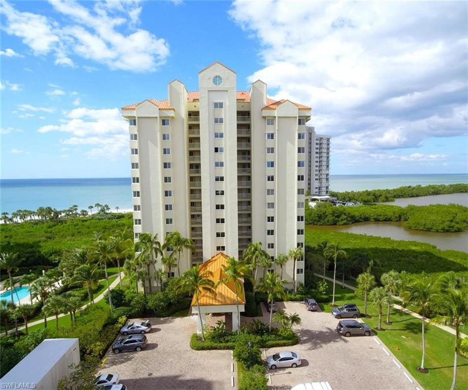 Rarely available 8th floor north side END Corner unit with direct views of the Gulf of Mexico and Clam Bay. Enjoy beautiful Gulf views and sunsets from your terrace. This beautiful beachfront condo is located at Naples Cay in the desirable Seagate Community. Only steps away from the beautiful white sand beach...this private guard-gated beachfront community is nestled between Park Shore and Pelican Bay. On site amenities include a heated pool, hot tub, work out facility, tennis courts, and more.  Now is the time to make this condo your own. Also terrific rental opportunities available.