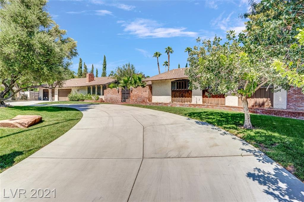 """Welcome to Highly desired Guard Gated """"Rancho Nevada Estates"""" community.  This custom layout is ready for the next generation owner.  Sitting on a cul-de-sac lot greeted by a circle driveway boasting well over a 1/2 acre lot with refreshing pool, an oversize covered patio extending the length of the house and a giant shade tree.  The interior has multiple ensuite bedrooms, big living room, elevated dining room, cozy family room and fun bar/game room, three real wood fireplaces and wood beams throughout living areas; these are just some of the unique features this mid-century home offers!  The home needs updating and is priced accordingly."""