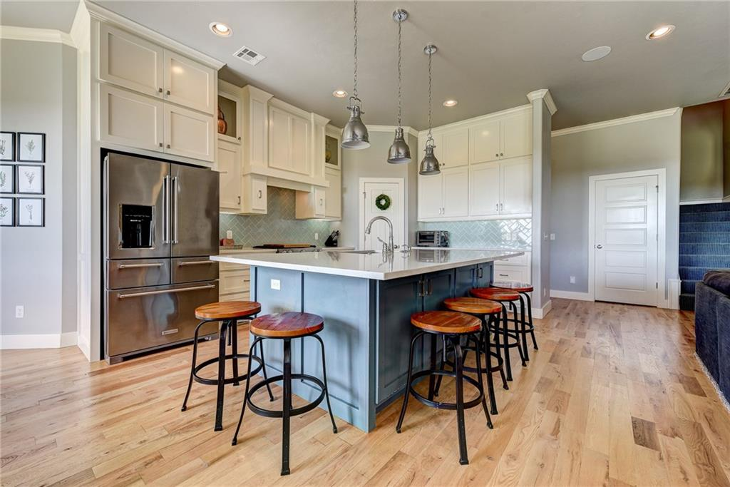 This is a true custom home with an open floor plan designed to entertain.  Spacious windows bring plenty of light into the living and kitchen. Large granite island in the kitchen with room to bake and serve easily.  Huge pantry and plenty of other storage. Unique to this home is the small bright room off the dining area with a sliding barn door.  The shampoo bowl and all will be removed and this makes a great flex room: office, butler's pantry, reading room, craft room or even a nursery since it also has another barn door to the master suite! This room has a safe room built right inside the bedroom closet. The convenience of a central vac is also built into this custom home.  Upstairs is a bedroom and full bath PLUS 2 bonus rooms!  So many storage cabinets upstairs!  Sidewalk around the entire home. Perfect for a growing family who would enjoy a pool, but not have the headache of the maintenance of a pool.... it's that close!  You will not be disappointed.  Set up your showing today!