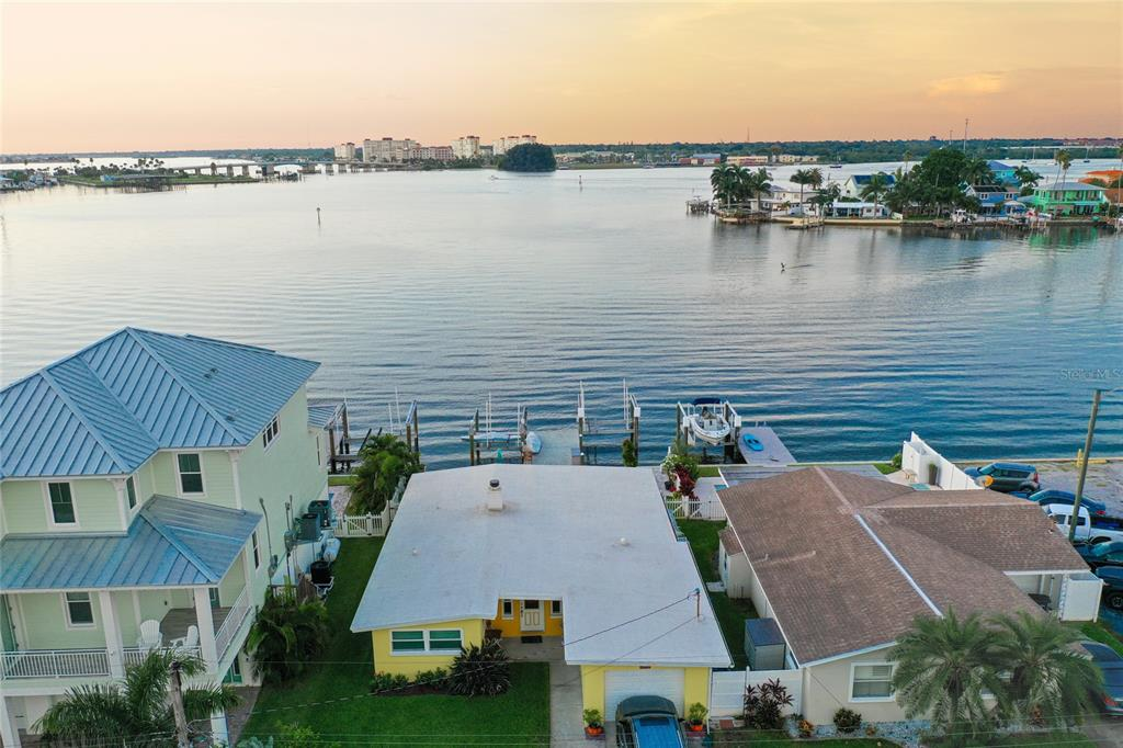 **UNIMAGINABLE OPEN WATERFRONT HOME at this price. See it for yourself today!** Ideally located in the protected intracoastal waterways of Boca Ciega Bay, this perfectly positioned waterfront home has INCREDIBLE OPEN WATER views. With deep sailboat water, quick access to the Gulf of Mexico, and the award-winning white sand beaches of Madeira Beach, it's a Florida lifestyle paradise. If you've been looking for a cute beach getaway with AMAZING views or the perfect lot to build your DREAM Florida home, look no further! From boating, to beaching, to the endless variety of activities and entertainment spots, like the renowned John's Pass, you're never going to want to leave this slice of waterfront paradise. With a 2021 AC, 2020 hot water heater, hurricane impact windows, hurricane impact sliding glass doors, and a 2019 seawall (including the neighbors on both sides), all of the big ticket items have already been upgraded! The dock features two 10,000lb lifts and already has water and electric connected. Video and virtual tours available upon request, as well as potential luxury build plans drafted for those looking to build up or start new. Don't miss out on this premier waterfront property, it's ready for you to call it home!