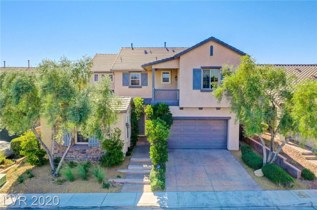 Stunning Model Home in Gated Community! Breathtaking Strip and Mountain Views! 3600 sq. ft. plus 170 sq ft of additional converted living space where the 3rd car garage was located. 4bed/3.5bath/2 family rooms/loft/2car garage/POOL. Additional living space has AC/Heat and a separate entrance from courtyard. Strip and mountain views! Chef's dream kitchen with professional range, expanded cabinetry, butlers panty/bar, breakfast nook PLUS formal dining room. All appliances included. Wood flooring, crown molding, speakers throughout, custom built-ins and walk-in closets. 2 fireplaces, 2 balconies, beach entry pool in backyard oasis.  Upstairs laundry room with sink and custom cabinetry. Stunning views toward strip and mountains from master balcony. Charming courtyard entryway to front door and also access to converted living space. Too many features to list. This dream home is a MUST SEE! STRIP VIEW! 3-D interactive tour!