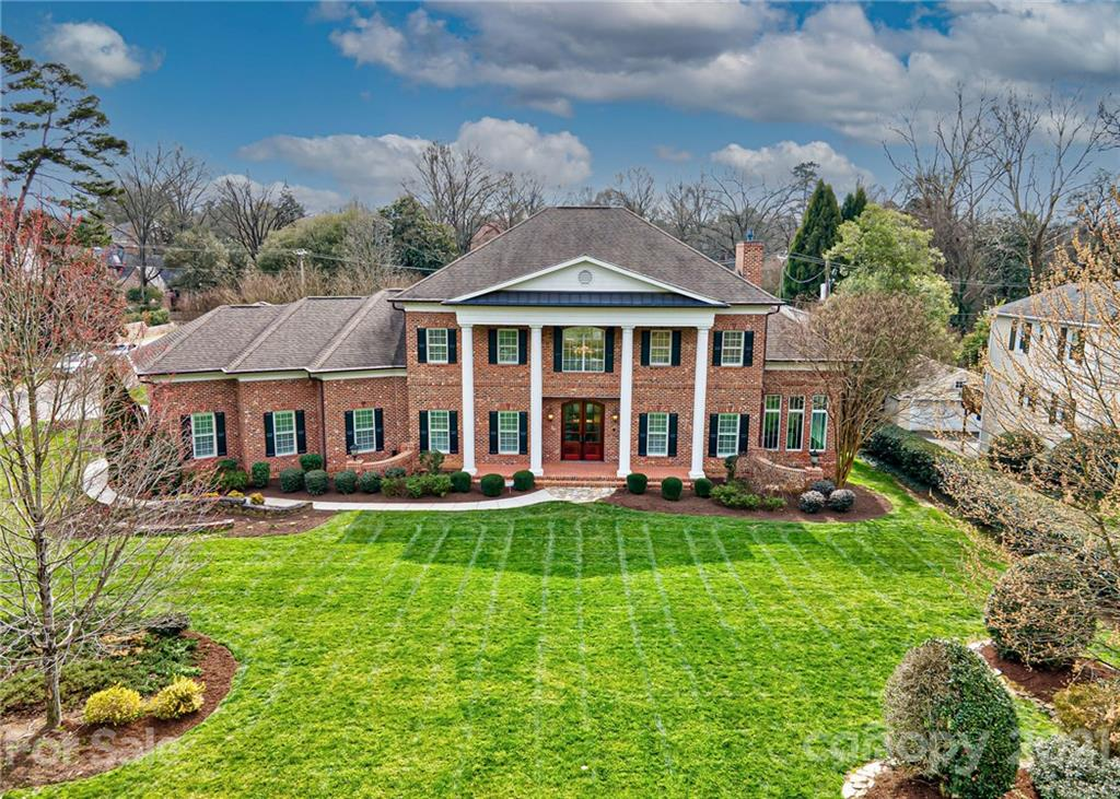 STUNNING custom brick home in Myers Park with soaring ceilings and luxury custom millwork. Gourmet kitchen with high end Thermador stainless appliances, pot filler, Large center island for entertaining, Dual ovens, Walk-In pantry, Butler's pantry open to the Dining Room, Breakfast Room & Great Room. Great Room with see thru fireplace to flex space/office area with custom built ins. Main floor Master Bedroom Suite, Master Bath with soaking tub & walk in closet. Sweeping staircase to Large secondary bedrooms with adjoining baths, Loft/exercise space. Gorgeous Tigerwood hardwoods on main. Dual staircases, 5Th bonus/bedroom with full bath and storage. Three car back load garage. Travertine, marble, custom closets in each bedroom. 8' solid doors, granite countertops. Outdoor living includes terrace with fireplace. Sealed Crawl Space. Dual Instant Hot water heaters. Grand Chandelier with drop down feature for convenient cleaning. Fabulous location close to Southpark, Cotswold & town.