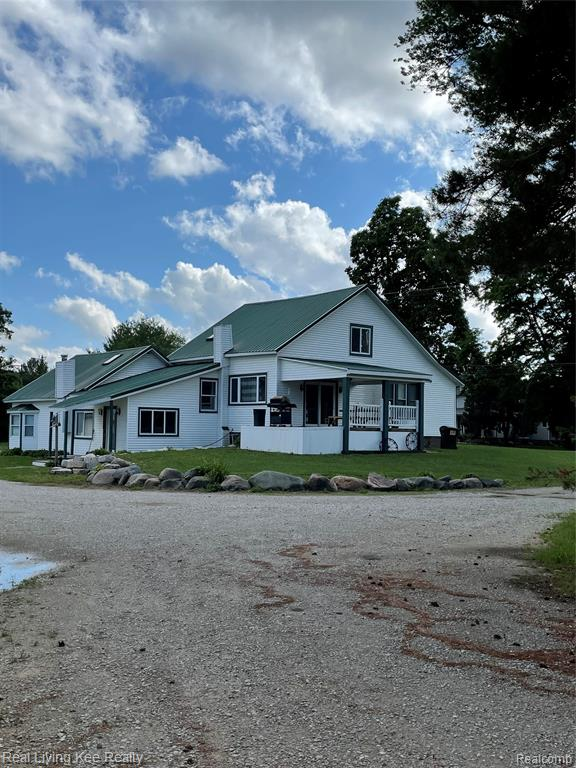 Updated farmhouse has an open and flowing floorplan. Beautiful parklike setting on this 5+acre w/a private pond! Possible split available. Home features LR w/open wood cathedral ceiling, 2 french doors leading out to deck, gas FP, and loft that would be a perfect office. Huge entry could easily be a study or office has a woodburning stove. Large eat-in Country Kit has all SS appliances, tons of counterspace and cupboards w/doorwall leading to a covered deck w/fan. Master bath is extra lg w/separate shower, whirlpool tub, french doors leading out to private deck. Home and all outbuildings are vinyl sided with metals roofs. Barn 60 x 40 has natural gas, drain field, 220 and a well for the barn not currently hooked up but a easy thing to do. Silo also on property. Driveway around the property will hold semis so perfect for a business owner. You can pull a semi into the barn to work on. Perfect also for lawn service owner, plenty of room to grow your own bushes and trees in the back .