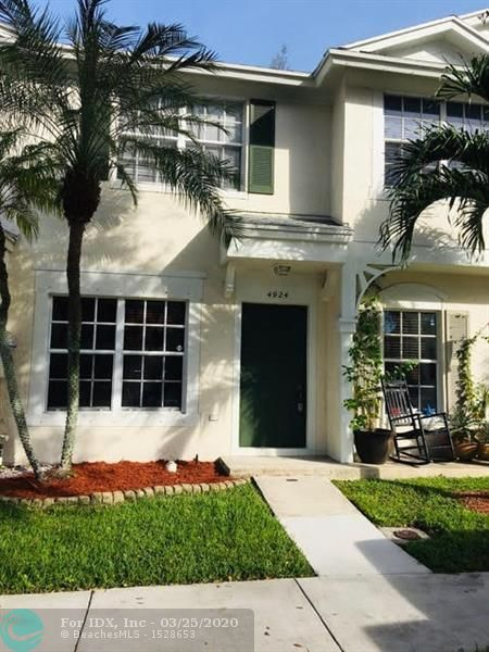 Location & Lifestyle! This gated community of Oakbridge is an amazing place to own a spacious, 2 bedroom Townhome in desirable Dania Beach. The perfect solution for those desiring a winter retreat without high costs, only $225 monthly maintenance fee, Newer AC, Water Heater & Washer/Dryer. Enjoy a morning coffee in your private screened in Patio & private yard area. Community maintains the manicured grounds, community pool, exterior paint, roof, playground & clubhouse. Built of Concrete with hurricane panel protection up to 165MPH winds. Only minutes to beach, restaurants, shopping, entertainment & Hard Rock Guitar & Casino.  Make your travel a breeze, close proximity to all major highways, airports & rail stations. SOLD AS-IS & AVAILABLE IMMEDIATELY UPON ASSOC APPROVAL & FUNDING!!