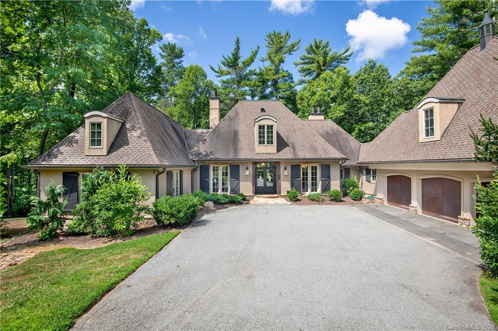 Rare opportunity in the Ramble! This Jack Arnold designed French Country home is nestled on a private lot, on a quiet cul-de-sac in an ideal location. This home backs up to the paved, wooded trail system and dingle creek, all just minutes to both Longmeadow Park and the Fitness Center with community kitchen, great room, and saline pool. This stately home is perfect for entertaining with its spacious decks and oversized rooms, and with 5 fireplaces, this special place is warm and inviting in every way. Our kitchen has been well used and is a bit worn to say the least.  You may want to add your designer touches to make it your own.   Don't forget to preview the sweeeeet guest quarters above the three car garage.  Enjoy!  Won't last long at this price per square foot. Seller is NC licensed Realtor.