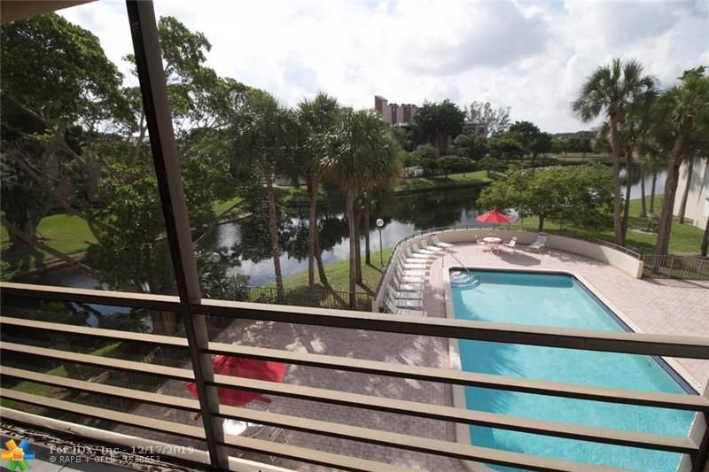 TRANQUIL CORNER UNIT. 3 BEDROOMS 2 BATH (CURRENTLY 3RD BEDROOM IS SETUP UP AS DEN, EASY TO ENCLOSE. LARGE SPACE 1,500 SQFT. ALL ROOMS HAVE EXTERIOR WINDOWS (GREAT LIGHT). GREAT WATER VIEWS. LARGE BALCONY. HURRICANE SHUTTERS FOR WINDOWS ALREADY INSTALLED. ASSIGNED PARKING SPACE. FULL AMENITIES, BUILDING HAS ELEVATORS. UNIT VIEW OF POOL. CLOSE TO SHOPPING, AMAZING BEACH IS ABOUT 15 MINUTES AWAY. CLOSE TO PALM-AIRE GOLF COURSES, ISLE CASINO, RACE TRACK, AND PARKS. FLEXIBLE FLOOR PLAN. YOU WILL LOVE THE AREA, GREAT FOR WALKING AND CLOSE TO EVERYTHING. VERY AFFORDABLE. EASY TO SEE UNIT.
